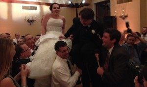 The newly married Abby and Sam dance the Hora, or traditional Jewish wedding chair dance.